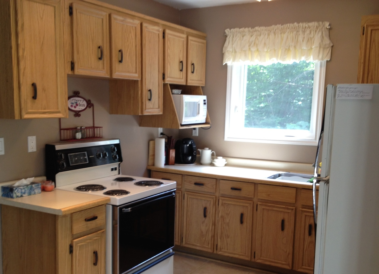 Kitchen with Stove, Fridge, Microwave, Sink, Coffee Maker
